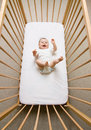 Baby girl in a crib Royalty Free Stock Photos