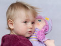 Baby girl with doll Stock Photo