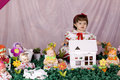 Baby girl and doll house Royalty Free Stock Photography
