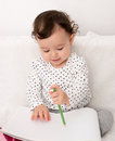 Baby girl drawing Royalty Free Stock Photo