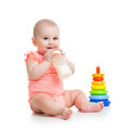 Baby girl drinking milk from bottle adorable Royalty Free Stock Photos