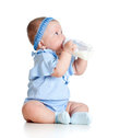 Baby girl drinking milk from bottlee without help Royalty Free Stock Photo