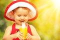 Baby Girl Drinking Orange Juic...