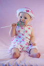 Baby girl eat lollipop candy Stock Photo
