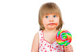 Baby girl eating a sticky lollipop Royalty Free Stock Images