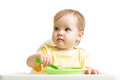 Baby girl eating yogurt or puree isolated on white background Royalty Free Stock Photo
