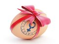 Baby girl egg gift with bow Stock Photo