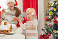 Baby girl enjoying Christmas cookies Royalty Free Stock Images