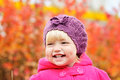 Baby girl in fall smiling with dimple cheeks Royalty Free Stock Photography