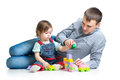 Baby girl and father play toys together Stock Photo