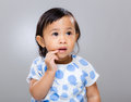 Baby girl finger touch mouth Royalty Free Stock Photo