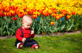 Baby girl in garden Royalty Free Stock Photo
