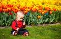 Baby Girl In Garden