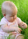Baby girl in grass Stock Photo