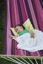 Baby girl in hammock little sleeping Royalty Free Stock Photos