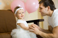 Baby girl the happy little smile with daddy indoor Royalty Free Stock Photo