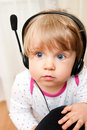 Baby girl in headphones Royalty Free Stock Image