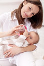 Baby girl held by her mother Royalty Free Stock Images