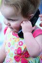 Baby Girl Holding A Cell Phone Royalty Free Stock Images