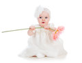 Baby girl holding flower gift on white background Stock Images