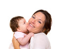 Baby girl hungry eating mother face hug Royalty Free Stock Photography