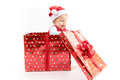 Baby Girl inside Christmas Gift Box Opens Present Royalty Free Stock Photo