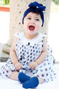 Baby girl laughing lovely and smiling to the camera Royalty Free Stock Photo