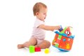 Baby girl lost in playing cute with toys wearing bodysuit Stock Photo