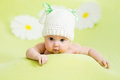 Baby girl lying green meadow daisy Royalty Free Stock Images
