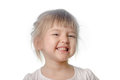 Baby girl makes cunning face white background Stock Image