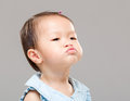 Baby girl making funny face Royalty Free Stock Photo