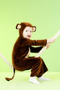Baby girl in monkey costume Stock Images