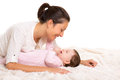 Baby girl and mother lying happy playing together Stock Photography