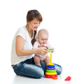 Baby girl and mother playing together with toy Stock Photos