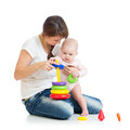 Baby girl and mother playing together with toy Stock Image
