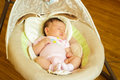 Baby girl newborn sleeping in the cradle on day at home Royalty Free Stock Photo