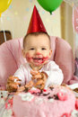 Baby girl one year old little with dirty faced solemnize birthday happy laughter vertical photo Royalty Free Stock Image