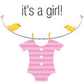 Baby girl onesie an image of a pink hanging on a clothesline with birds Stock Photo