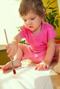 Baby girl with paint brush Stock Photography
