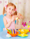 Baby girl painting easter eggs cute decorated with colored paint at home holiday celebration spring season Royalty Free Stock Photography
