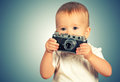 Baby girl photographer with retro camera beauty Royalty Free Stock Images