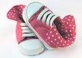 Baby girl pink converse sneakers on a white background Royalty Free Stock Photography