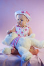 Baby girl pink teddy bear sitting toy Stock Photos