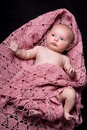 Baby Girl in Pink Woolen Shawl Stock Photo