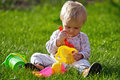 Baby girl play on grass Stock Photos
