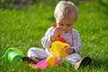 Baby girl play on grass Stock Photos