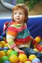 Baby girl playing Royaltyfri Foto