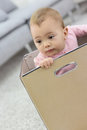 Baby girl playing in carboard box Royalty Free Stock Photo
