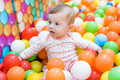 Baby girl playing with colorful balls Royalty Free Stock Photo