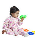 Baby Girl Playing with Colorful Rings Royalty Free Stock Images